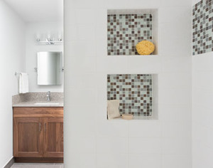 Hall bath mosaic shower niches.